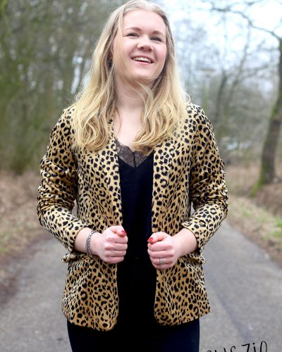 Outfit: Leopard Print and a Black bag